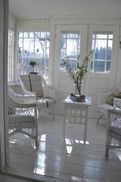 white wicker sunroom