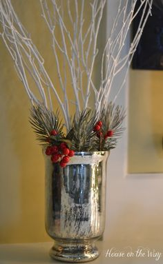 Christmas Mantel with Mercury glass, red berries and winter white branches