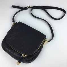 "[Vince Camuto] Riley Leather Crossbody Bag Zipper A classic and chic Crossbody bag. Gold zippers and hardware and a luxe edge. Rounded bottom. Textured soft leather. Magnetic snap closure. Slip pocket on back. Zip pocket on front flap. Interior zip pocket. Lined.  Dimensions: 9.5"" Wide x 8"" High x 1.75"" Deep Strap Drop: 22"" Condition: EUC. Like new. No flaws.   No Trades! Vince Camuto Bags Crossbody Bags"