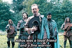 Treville presiding over Athos's funeral with a little help from Aramis and Porthos 1x10 Musketeers Don't Die Easily