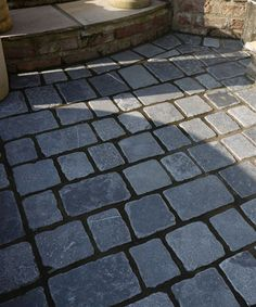 Blue grey stone cobbles  http://www.naturalstoneconsulting.co.uk/driveway-cobbles-blue-grey-setts