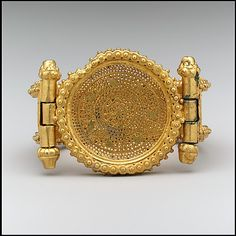 Bracelet (one of a pair) Date: ca. 400 Geography: Made in probably Rome Culture: Byzantine Medium: Gold Dimensions: Overall: 2 x 2 x 1 in. x x cm) strap: 6 in. Byzantine Jewelry, Medieval Jewelry, Byzantine Art, Ancient Jewelry, Antique Jewelry, Vintage Jewelry, Renaissance Jewelry, Wiccan Jewelry, Historical Artifacts