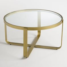 "a little more ""midcentury mindy"" than sims classic, but the glass / metal lines might make the apt seem bigger than a big opaque table. just a thought Round Glass and Metal Ilene Coffee Table Round Glass Coffee Table, Unique Coffee Table, Coffee Table Design, Coffee Tables, Affordable Furniture, Cheap Furniture, Furniture Outlet, Discount Furniture, Luxury Furniture"
