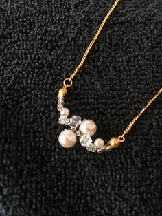 knotted beads and pearl necklace. gold chain.