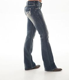 Ripped up, heavily distressed and blinged out! That's how cowgirls like their jeans. Made from premium denim these women's jeans by Cowgirl Tuff features thick white stitching throughout, thick cluste