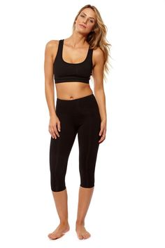Strappy Cross-Roads Sports Bra Black S. 87% Polyamide, 13% Spandex. We love the simple minimalist top that can be worn with virtually anything. Our high quality fabric is form-fitting, UV protected, moisture-wicking, and adaptable to any activity. Perfect for yoga or Leisure.