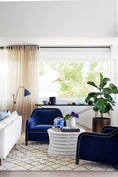 """It's a very relaxed palette that draws the eye outside, towards the gum trees and the water, rather than being focused inside,"" says Ben. The exception is in the second living area at the rear (the ""cosy room""), overlooking the garden. ""We wanted it more layered and intimate,"" says Justine. ""It has a richer, deeper palette, with more pattern."" Gubi Bestlite BL3 **floor lamp** from [Cult](http://www.cultdesign.com.au/