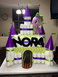 Purple and green dragon castle diaper cake for baby shower