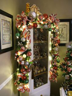 oh my, over the top garland. Love the house on top!! Perfect...