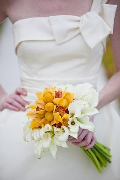 bouquet with whatever your wedding color is in the middle