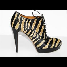 GUCCI betty lace-up high heel platform bootie 100% authentic Gucci betty lace-up high heel platform bootie black/caramel zebra-printed calf hair black leather trim light gold hardware Made in Italy capped shoelaces 120 mm heel with a 20 mm platform Retail price $995 This item is brand new!! Comes with the original box, Dustbag and and and additional cap for the shoelace Gucci Shoes Lace Up Boots