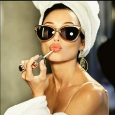 Audrey Hepburn....this would be cute framed in a bathroom.
