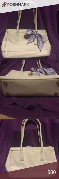 """Coach Madeline purse - white w/silk scarf Rarely used. Has been sitting in dust bag in my closet.  Front full-width pocket with metal turn lock closure.  Back full-width pocket with Coach embossed on the leather.  Zipper closure for main to compartment.  Inside: lavender fabric. 2 side pockets & 1 zipper wall pocket.  Double rolled straps with 8"""" drop  4 rounded feet bottom.  Some dark marks on bottom handles from storage in my rubber bin. Would probably come off with leather cleaner…"""