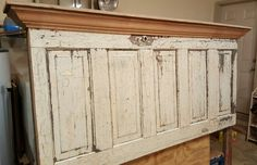 King size headboard made with an  old antique wooden door