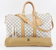LOUIS VUITTON Keepall Bandoulire 45 Damier Azure WHITE Travel Bag. Save 35% on the LOUIS VUITTON Keepall Bandoulire 45 Damier Azure WHITE Travel Bag! This travel bag is a top 10 member favorite on Tradesy. See how much you can save