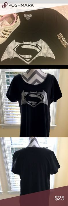 Torrid Batman V Superman Justice League Tee SZ 14W This preloved and perfect Torrid tee is inspired from The Justice League Movies and has a conjoined Superman & Batman Logo across the Front. Woman's Plus Size 14W or size 1. Please look at the Torrid size chart for your measurements before purchasing. Reasonable offers will always be considered. A reasonable offer chart is included in the listing. No trades or low ball offers. Thanks! torrid Tops Tees - Short Sleeve