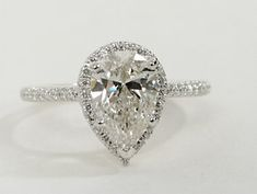 Beautifully designed, this diamond engagement ring showcases micropavé-set diamonds to frame the Pear Shaped diamond of your choice set in 14K White Gold.