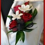Rose and Stephantois Pin On #Corsage Price: $20.98 Red Roses with stephanotis with pearls in the middle accented with greens and black ribbon.