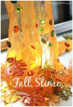 Fall Slime Recipe Decorated With leaves and Sequins Oozing Down. It is so simple, you will have awesome slime in 5 minutes that you can play with over and over.