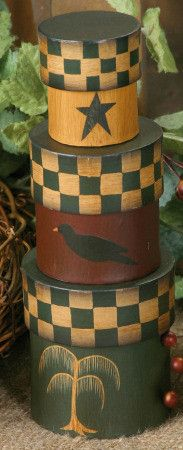 So many uses for these painted primitive stacking boxes. Great country colors are accented with star, crow, and willow tree. Affordable country decor that adds that little extra charm. Painted Paper,