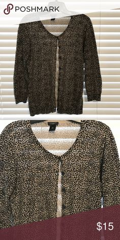 Ann Taylor cheetah leopard print cardigan Sz Med Button down cardigan from Ann Taylor size Medium. Color is a tan and black cheetah/leopard print. Excellent condition. Worn 2-3x's Ann Taylor Sweaters Cardigans