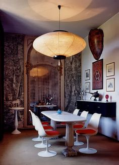 Funky dining area with Saarinen furniture, paper lantern, and architectural panache