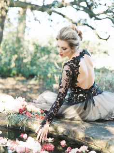 Dramatic Black Lace Wedding Dress with an Open Back