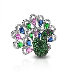 Valentines Day Gifts Bling Jewelry Sapphire Pink Topaz Emerald Color CZ Peacock Brooch Animal Pin Bling Jewelry. $69.99. Pear CZs are 3.5mm. Peacock brooch pin. Weighs 11.5 grams. Brooch is 1.25 by 1.5in. Rhodium plated brass, CZs
