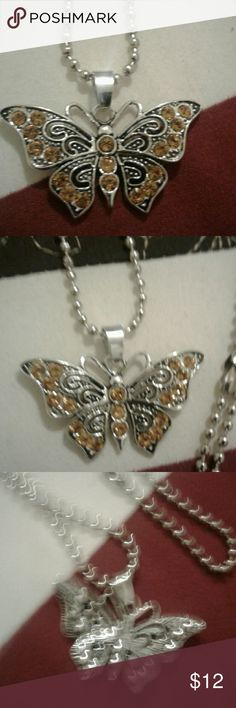 "Long 28"" CZ Butterfly Pendant Necklace!! LONG  Pretty CZs Butterfly Pendant NECKLACE!! Mustard Stones with Black Accent on a silver base. Chain Length:  28 1/2"" Pendant:  approx 2"" by 1"" Material: Alloy and Rhinestones Jewelry Necklaces"