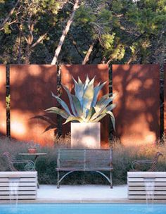 Corten steel fence. Corten steel is a group of steel alloys which were developed to eliminate the need for painting, and form a stable rust-like appearance if exposed to the weather for several years.