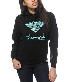 A tribal print diamond graphic and script is printed on the front of a soft and thick fleece hoodie for the perfect combination of premium…