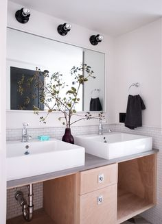 The downstairs bath features Waterworks'Highgate Low-Profile One-Hole Deck-Mounted Faucet($703 each) paired with Duravit Vero sinks. Black Bathroom Sets, Bathroom Colors, Bathroom Ideas, Bathroom Makeovers, Bathroom Small, Bathroom Vanities, Master Bathroom, Masculine Bathroom, Cute Wall Decor