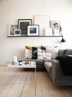 The is a  very appealing group of framed items on a shelf. Love the sofa pillows too.    - http://weheartit.com/entry/35081146/via/angelikka