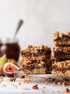 If Fig Newton's are your jam, you'll go crazy for these easy homemade walnut and fig crumble bars. They're chewy bars filled with gooey fig butter nestled between a buttery brown sugar and oat crust and walnut crumble topping – and packed with yummy fall flavor! - Find the Recipe on forkknifeswoon.com #figbars #chewy #dessert #crumbbar #oat #walnut #figjam #dessert Fig Dessert, Dessert Bars, Dessert Recipes, Desserts, Baking Recipes, Cookie Recipes, Fig Butter, Walnut Butter, Oat Crumble Topping