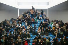 """Cyprien Gaillard: """"Recovery of Discovery"""" (...) Taking the participatory aspect of the work very seriously, a huge crowd covered the oversized beer-pyramid, smoking, getting drunk, and celebrating in the midst of paper rubble and shattered glass."""""""