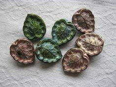 """Vintage glass leaf shaped buttons green pale lustre approx 5/8"""""""