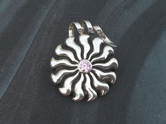 Wax carved and cast in the lost wax method. This is a very chunky sterling silver daisy pendant. Key features: * Sterling Silver Daisy with round pink 7 mm cubic zirconia. Wax Carving, Daisy, Range, Jewellery, Sterling Silver, Studio, Pendant, Pink, Cookers