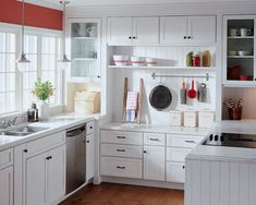 I'm really into kitchens, so here is thought number one.  I love the clean look which is modern and vintage at the same time.  And the undermount sink is a must.