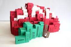 cutouts of buildings making the shape of an apple and NYC in the middle. pop up made cool.