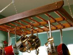 Hang 'em High  Pots and pans take up a lot of cabinet space. Hanging cookware on a rack suspended from the ceiling will free up a cabinet or two, and it will add more style to your kitchen.  You Might Also Like...  How to Build a Hanging Pot Rack