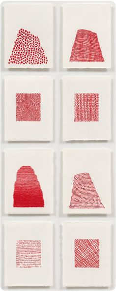 Red embroidery thread on thick white watercolor paper