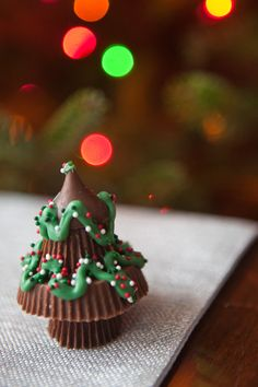 Peanut Butter Christmas Trees. Ingredients: 2 mini Reeses cups, 1 regular Reeses cup, 1 hershey kiss, melted chocolate, sprinkles