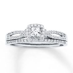A princess-cut diamond outlined in sparkling round diamonds 14K white gold band. The bridal set has a total diamond weight of 1/2 carat. J980