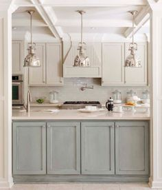 Love the blue-grey base with light grey uppers.  And the lights - I love them too. Oh, and the backsplash... and the marble... and the coffer ceiling... and the pot filler...