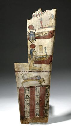 Egypt, Late Dynastic period, ca. 712 to 332 BCE. A huge fragment of a wooden mummy sarcophagus, brightly painted on a thin layer of gesso with natural pigments. From the top down, the artwork includes: a pectoral; a standing Anubis and a kneeling goddess who appears to be Bastet on a thin platform; a scarab with spread, bird-like wings and a sun disk (Khepri); the goddess Isis, also with wings and a sun disk; a sarcophagus on a lion's back (perhaps Sekhmet); and three columns of hieroglyphs.