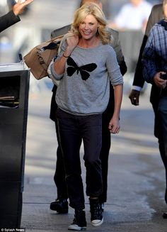 Actress Julie Bowen arrived at the set of Modern Family wearing a pair of Ash 'Virgin' black buckle trainers