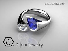 Dreams Come True with A Jour! - A Platinum Bypass design ring with a Pear Shaped Blue Sapphire and Brilliant Round Diamond!
