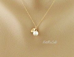 Initial Pendant Pearl necklace, Personalized Monogram Necklace, Gold Leaf charm Necklace, Bridesmaid gifts, Sister, Flower girl, Wedding. $24.00, via Etsy.
