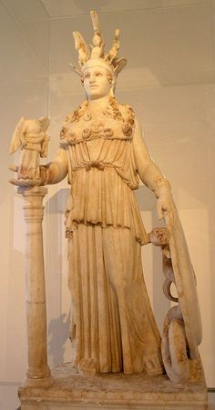 An ancient Greek statue of Athena Parthenos (Phidias); the goddess of arts and warcraft is depicted with her symbolic attributes: a shield, a helmet and a figure of the victory-goddess Nike. (National Archaeological Museum of Athens)