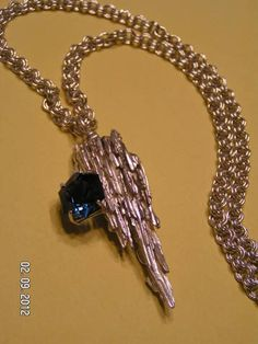 This is a spinel I donated to the Central Brevard Rock & Gem Club for their Grand Prize in the 2012 Gem Show. The broom straw silver and the chain were done by club members.
